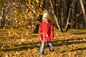 Children Throw Autumn Leaves 2