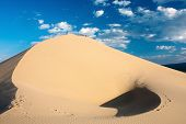 stock photo of quicksand  - sandstone desert with beautiful sky  - JPG