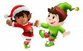 stock photo of gnome  - Two happy Christmas elves enjoying a Christmas dance in Santa outfit and elf clothes - JPG