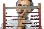 picture of interpreter  - a pensive accountant with an old abacus - JPG
