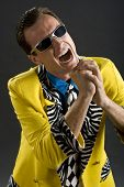 stock photo of rockabilly  - retro style rockabilly singer from 1950s in yellow jacket - JPG