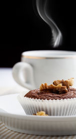 foto of chocolate muffin  - Cup of fresh coffee with chocolate muffin  - JPG