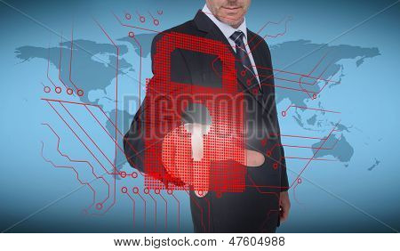 Businessman selecting a red padlock with world map on the background