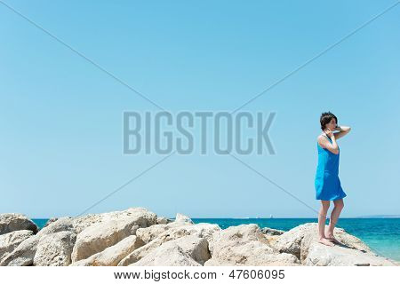 Young Girl Standing On Rocks