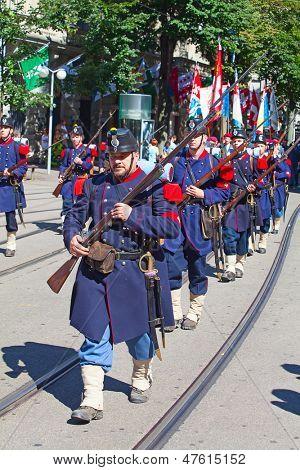 ZURICH - AUGUST 1: Unidentified men 19th century army uniform participating in the Swiss National Day parade on August 1, 2012 in Zurich, Switzerland.