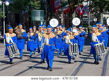 ZURICH - AUGUST 1: Zurich city orchestra in traditional costumes participating in the Swiss National Day parade on August 1, 2012 in Zurich, Switzerland.