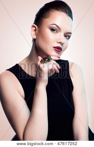 fashion model posing in exclusive jewelry. Professional makeup and hairstyle