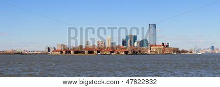 New Jersey Hoboken skyline panorama over Hudson River with skyscrapers and blue clear sky viewed from New York City Manhattan downtown.