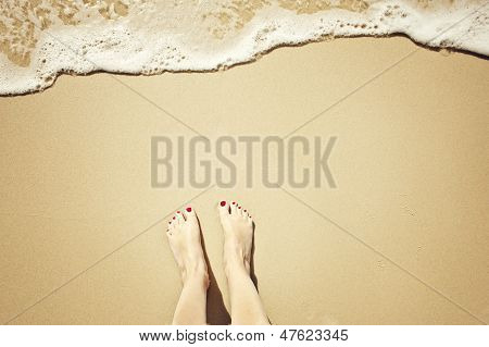 feet on the beach, center