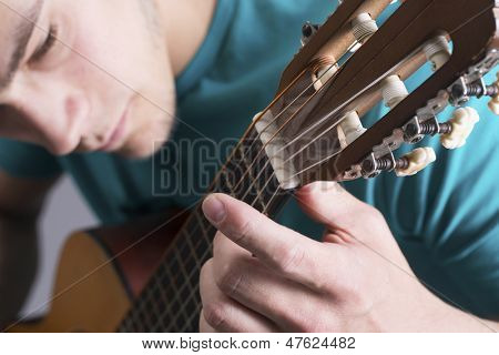 Close-up Of Young Man Playing Guitar