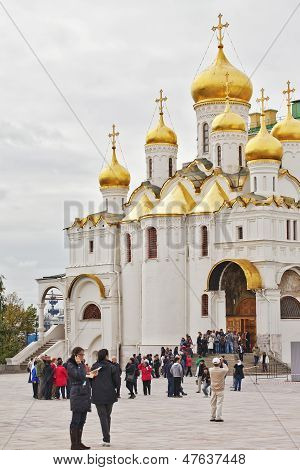 Tourists near the Cathedral of the Annunciation in Mosev Russia