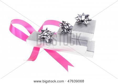 silver gift box with pink bow isolated over white background