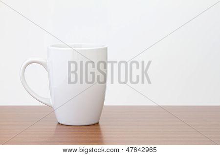 White mug on dark wooden table