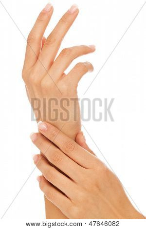 Young woman hands with french manicure over white background