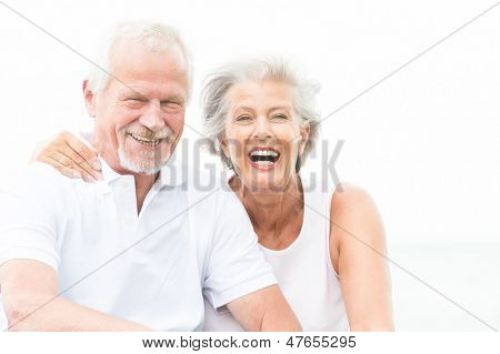 Happy and smiling couple in front of white sky