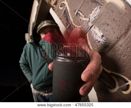 Man With Hood And Spray Paint