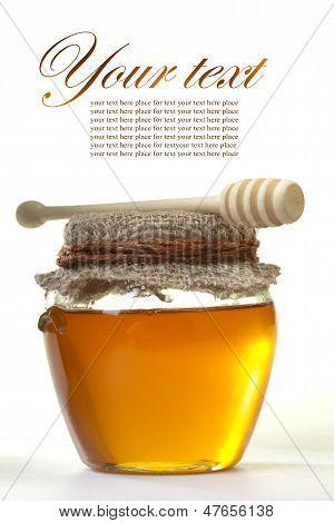 honey and a wooden honey dipper