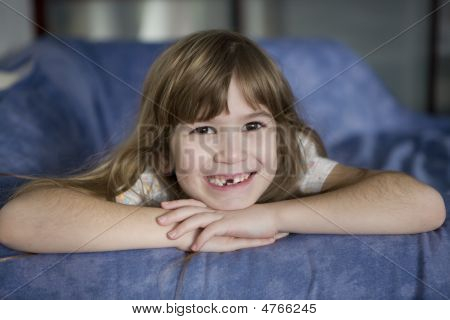 Closeup Portrait Toothless Cute Smiling Seven Year Girl With Long Hair