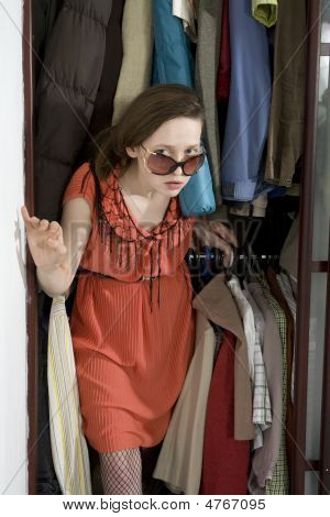 Young Attractive Woman Check Her Clothes Before Shopping. Girl Wearing Stylish Glasses Go Out From W