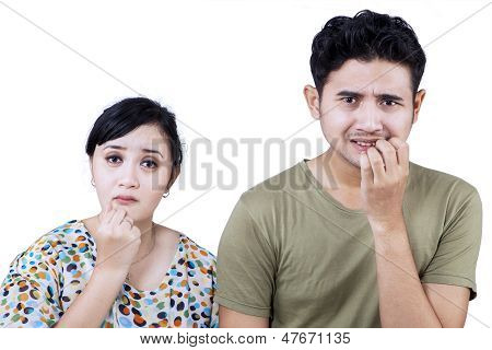 Afraid Couple Expression Biting Nails - Isolated