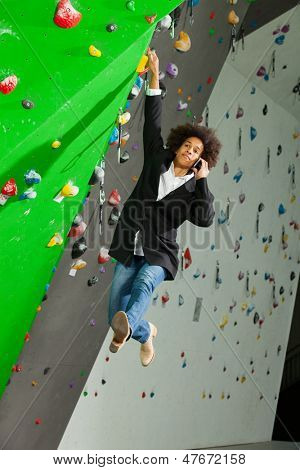 young business woman hanging at wall, beautiful girl. she is in a gymnasium