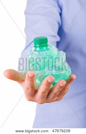 Businessman holding a crushed bottle.