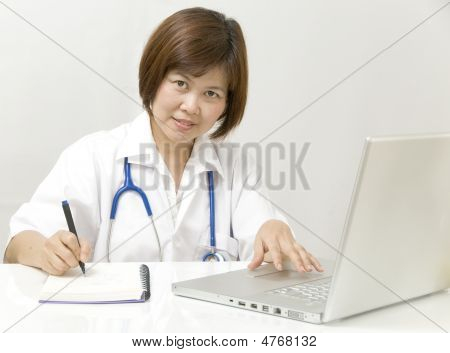 Physician At Her Desk