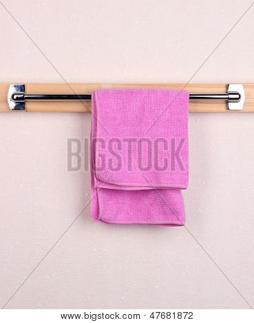 Bath towel on crossbar in room