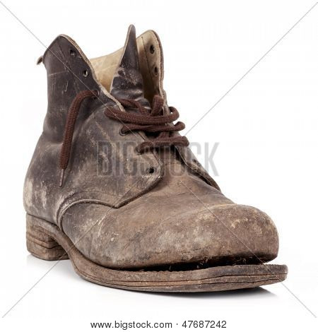 Old worn boot isolated on white.