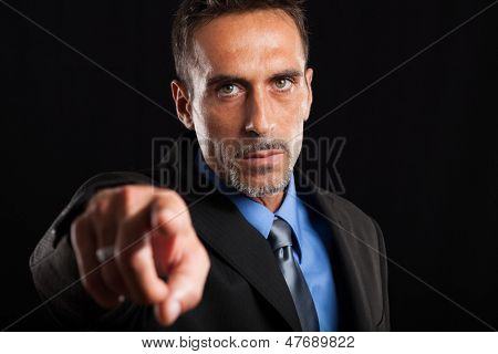 Confident businessman pointing his finger at you