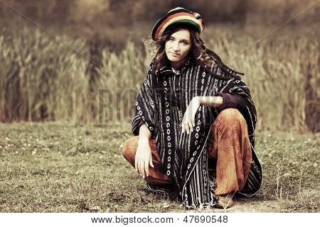 Young rastafarian woman on nature