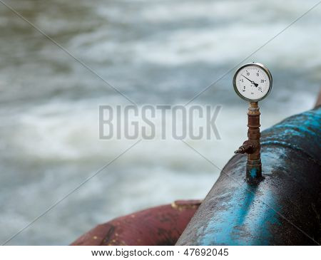 Barometer On A Blue Rusty Water Pipe