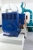 foto of hydro-electric  - Electric generator in a small hydro power plant - JPG
