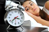 stock photo of fatigue  - Clock with sleep at night - JPG