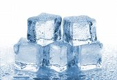 picture of cube  - Five melted ice cubes with water drops on white background - JPG