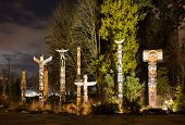 picture of indian totem pole  - The Totems in Stanley Park Vancouver at night - JPG