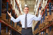 picture of warehouse  - Portrait Of Manager In Warehouse - JPG