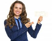 picture of air hostess  - Smiling business woman pointing on air tickets - JPG