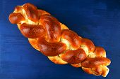 baked product : challah over blue painted wooden board