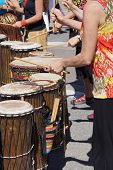 stock photo of penticton  - Drums played by women in brightly colored clothes Penticton British Columbia Canada - JPG