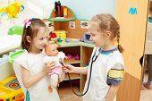 stock photo of doll  - Child in kindergarten - JPG