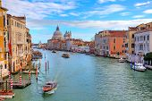 View of famous Grand Canal and Santa Maria della Salute basilica on background in Venice, Italy.