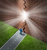 image of hope  - Breaking the wall business concept with a businessman using a sledge hammer to break through a huge brick obstacle creating a glowing crack showing hope and opportunity through confident leadership - JPG