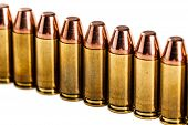 image of 9mm  - a row of unused 9mm bullets isolated on white - JPG