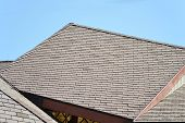 foto of shingles  - A rooftop of brown slate shingles in the sun - JPG