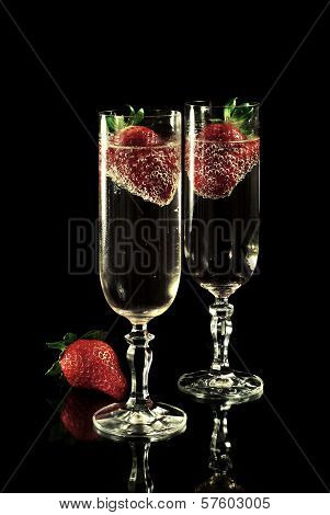 Golden champagne with strawberries