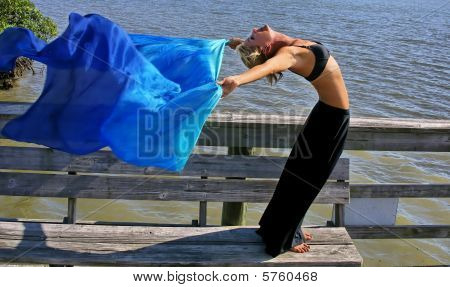 Woman Does Yoga In The Sun