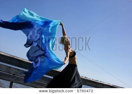 Woman Letting Silk Fly