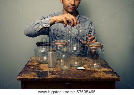 Man Is Preparing His Jars For Homecooked Preserve