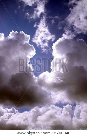 Beautiful storm / cumulus clouds forming in a blue sky